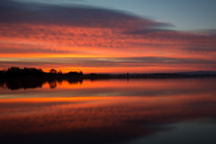 Reflection of  Burning Sky During Sunrise/Sunset Royalty Free Stock Photo
