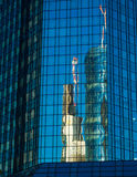 Reflection of business buildings  in a glass facade, Frankfurt, Stock Image
