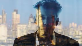 Reflection of a businessman looking out of a window in London. Reflection of a businessman daydreaming looking out of a window at night working late with the stock video footage