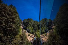 Reflection of cable railway in building royalty free stock images