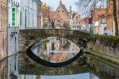 Reflection in the canal in Bruges, Belgium Stock Photo