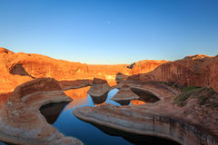 Reflection Canyon with a full moon, Utah, USA. Royalty Free Stock Photo