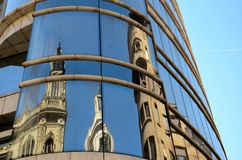 Reflection of cathedral on modern building windows Belgrade Serbia. Belgrade, Serbia - March 21, 2015: A reflection of a historical architectural building on the Stock Photos
