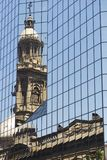 Reflection of the Cathedral of Santiago tower in the windows of the modern building at Plaza de Armas in Santiago, Chile. Royalty Free Stock Image