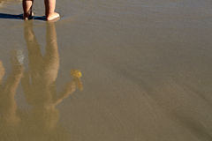 Reflection of child in water Stock Photo