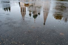 Reflection of Church in asphalt stock photography