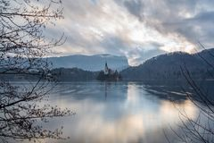 Reflection of the Church of the Assumption of Mary on Lake Bled stock photo