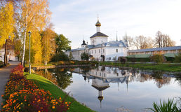 Reflection of the church in the pond. Autumn. Monastery. Reflection in the pond royalty free stock image
