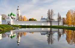 Reflection of the church in the pond. Autumn. Monastery. Reflection in the pond royalty free stock images