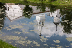 A reflection of a church. In the Spaso-Prilutsky monastery. A reflection of a church in a pond. In the Spaso-Prilutsky monastery Stock Photos