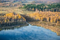Reflection of Cirrus clouds in a small forest lake in the Pushkin mountains Museum-reserve. royalty free stock photography