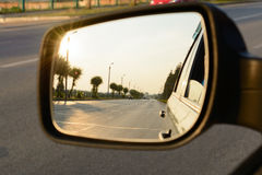 Reflection of a city street in the mirror car Royalty Free Stock Photography