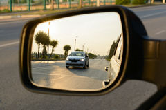 Reflection of a city street in the mirror car Royalty Free Stock Image