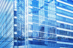 Reflection of city tower on modern window buildind Stock Photography