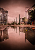 Reflection of City in Water at Sunset Royalty Free Stock Images