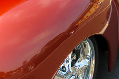 Reflection of Classic Car in Red Fender. A green classic car is reflected in the red fender of a car royalty free stock images