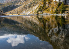 Reflection of cloud in mountain lake. Royalty Free Stock Photos