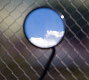 Reflection of clouds on a blue sky in a motobike mirror Royalty Free Stock Photography