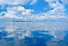 Reflection of clouds on calm and tranquil ocean Royalty Free Stock Photos