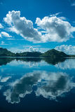 Reflection of clouds. In the early morning while traveling by boat, Komodo Stock Photography