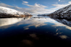 Reflection of clouds in fjord Stock Photo