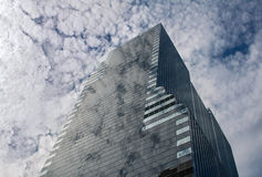 Clouds reflection in a glass skyscraper Royalty Free Stock Image