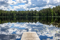 Reflection of clouds in the lake with boardwalk Stock Image