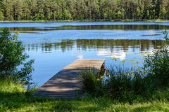 Reflection of clouds in the lake with boardwalk Royalty Free Stock Photography
