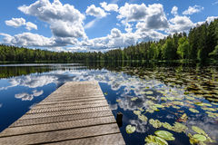 Reflection of clouds in the lake with boardwalk Stock Photography