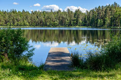 Reflection of clouds in the lake with boardwalk Stock Photos