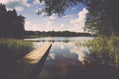 Reflection of clouds in the lake with boardwalk Royalty Free Stock Images
