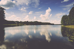 Reflection of clouds in the lake with boardwalk Stock Images