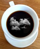 Reflection of clouds in mug of coffee, photographed in South Africa