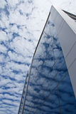Reflection of clouds on office building Stock Images