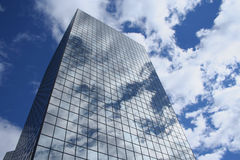 Reflection of clouds in skyscraper Stock Photos