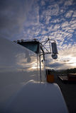 Reflection of cloudy sky on the cab white classic powerful truck Royalty Free Stock Photo