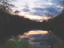 Sunset reflected in lake Stock Images