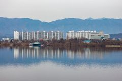 A reflection of a cluster of condominium in a mountainous region royalty free stock photo