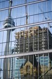 Reflection of cn tower and construction. In down-town on the glass of skyscraper stock photos