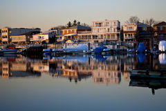 Reflection of coastline buildings Stock Images