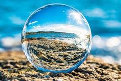 Reflection of coastline, Sandefjord, Norway. Coastline of Sandefjord, Norway reflected in crystal ball on sunny day stock photos