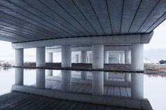 Reflection in the cold water under the A5 highway bridge. In Amsterdam the Netherlands royalty free stock photo