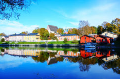 Reflection of colorful houses and building in river stock image