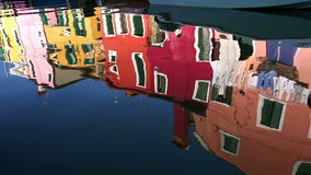 Reflection of a colorful houses in water canal, Burano island, Venice, Italy stock footage