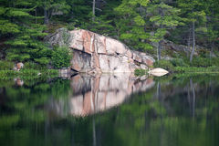 Reflection of Colorful Rock in the Lake Stock Image