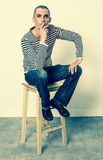 Reflection concept for man sitting on stool having doubts Stock Photography