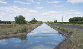 Reflection in Concrete Irrigation Channel. Stock Images