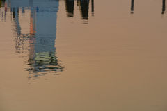 Reflection of the conning tower of a mud tugboat in the sunset w Royalty Free Stock Photography