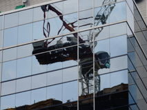 Reflection of the construction crane, at Massey Tower, on Yonge Street, 2017 08 22 -h Stock Image