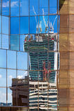 Reflection of a construction site in the windows Royalty Free Stock Image